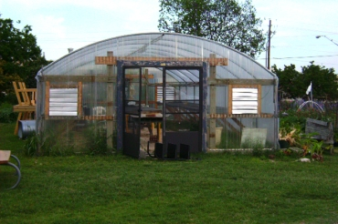 The garden's greenhouse was was where the peppers and eggplants were.